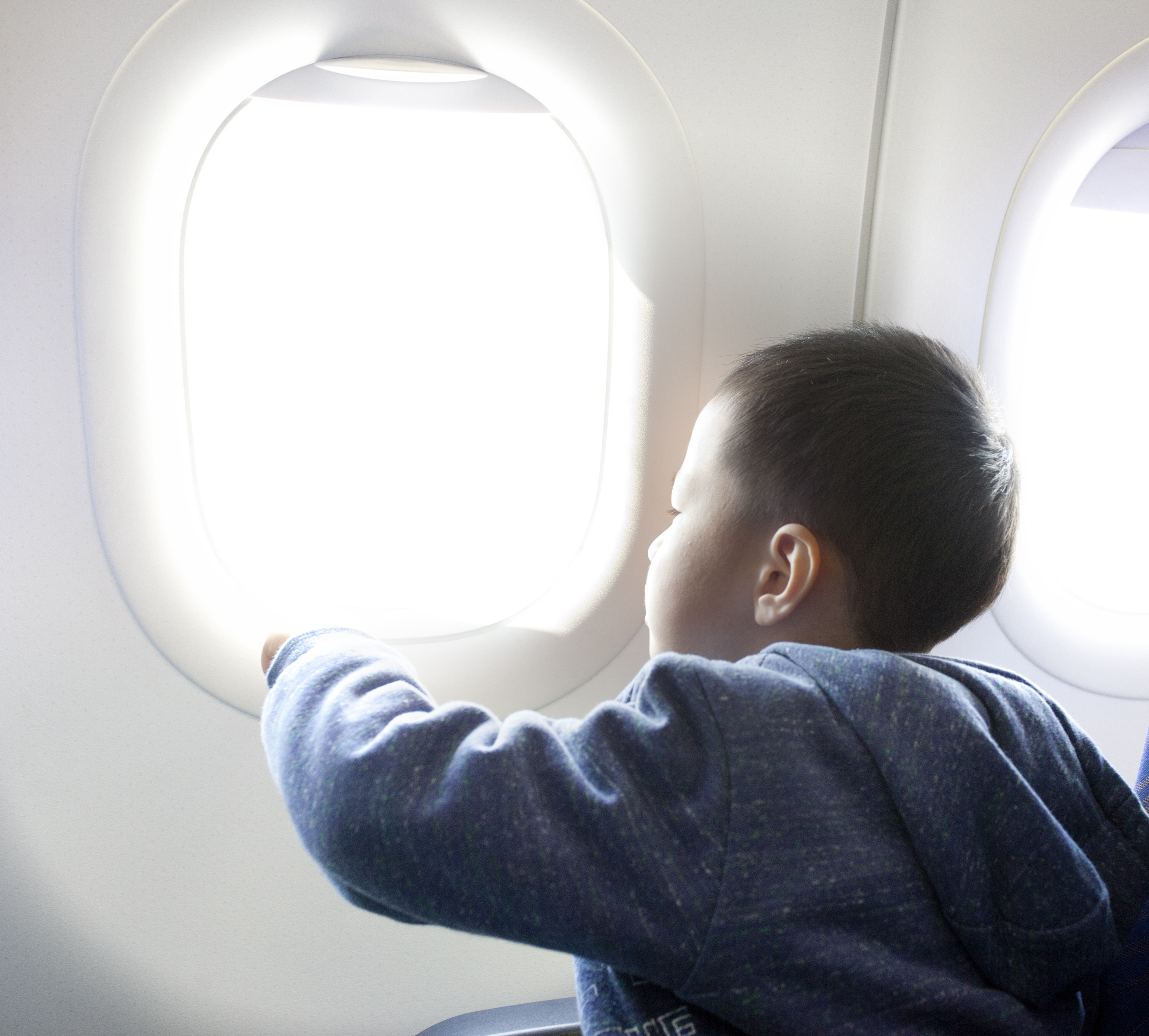 Flying with Young Kids? A Mom Reveals Her Top 23 Survival